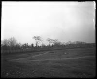 Bushwick: partly landscaped field adjacent to Union Cemetery, undated. Cemetery visible in background.