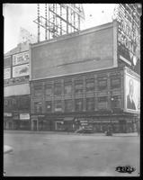 Broadway at West 47th Street, New York City, February 27, 1926: Arrow Collars (partial), Camel Cigarettes (partial), Chesterfield Cigarettes (faded), Ford Cars, 'The Sea Beast' at the Warner Theatre (partial). Others unreadable.