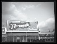 125th Street between Seventh Avenue and Lenox Avenue, New York City, September 1934: Rheingold Beer. Also storefronts of Leight Outfitters (partial), Orient Photo Plays (partial).