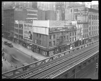 Sixth Avenue and 27th Street, April 1925: Chesterfield Cigarettes; painted signs for David Aaron & Co.. (lace makers), Leon Heller Manufacturing Furrier, Kaye & Einstein Furriers. Also 3 empty billboards.