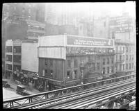 Sixth Avenue and 27th Street, April 1925: Chesterfield Cigarettes; painted sign for Leon Heller Manufacturing Furrier, David Aaron & Co. Lace and Embroidered Novelties. Also 3 empty billboards.