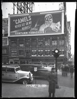 Broadway at West 47th Street, New York City, January 31, 1934: Camel Cigarettes, Sunkist Oranges (partial).
