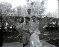 Angie and Nellie and Ada Moore in hammock at St. George's rectory, Hempstead, N.Y., September 4, 1891.