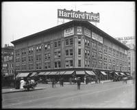 Broadway and West 57th Street, New York City, circa 1919: Hartford Tires, Fry Plugs, New York School of Automobile Engineers, Carbone, Wilson Whiskey, Henry Siegel The 14th Street Store, Silver Brand Collars. Storefronts for the Hartford Rubber Works Co.