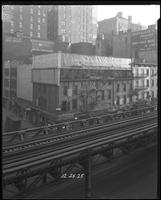Sixth Avenue and 27th Street, December 29, 1925: Chesterfield Cigarettes; painted signs for David Aaron & Co.. (lace makers), Leon Heller Manufacturing Furrier, Weiss Trimming Company. Also 3 empty billboards.
