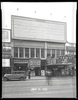 125th Street between Seventh Avenue and Lenox Avenue, New York City, May 31, 1933: Camel Cigarettes (partial), 1 empty billboard. Also storefronts of Tip Top Shoe Shop, Orient Photo Plays.