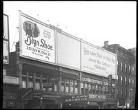 125th Street between Seventh Avenue and Lenox Avenue, New York City, February 1922: Brooklyn Shoe ['Blyn Shoe'], New York Campaign for Jerish War Sufferers. Also storefronts of Ideal Shoe Shop, Christensen School of Rag and Jazz, Orient Movies, Leight Bro