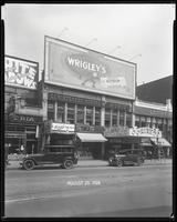 125th Street between Seventh Avenue and Lenox Avenue, New York City, August 29, 1928: Wrigley's Double Mint Gum. Also storefronts of Ideal Shoe Shop, Toby's Men's Shop, Christensen School of Music, Orient Photo Plays, Leight Brothers Outfitting Company (p