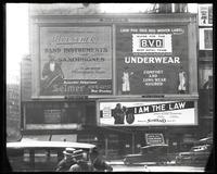 Broadway at 47th Street, New York, May 1922: Buescher True Tone Musical Instruments, 'I Am the Law' (motion picture) at the Mark Strand Theatre, BVD Brand Underwear