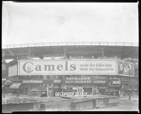 Eighth Avenue and Cathedral Parkway [i.e. 110th Street], New York City, December 27, 1928: Camel Cigarettes, Wrigley's Spearmint Gum.  Also 1 empty billboard.