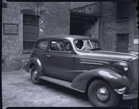 Car with broken windows; probably during the Eagle Pencil Company Strike, probably June-July 1938.