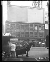 Broadway, 47th Street, and Seventh Avenue, New York City, April 28, 1926: 2 empty billboards.