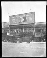 125th Street between Seventh Avenue and Lenox Avenue, New York City, June 24, 1927: Palisades Amusement Park, Wrigley's Double Mint Gum. Also storefronts of Ideal Shoe Shop, Toby's Men's Shop, Christensen School of Rag and Jazz, Orient Photo Plays, Adam H