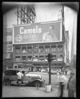 Broadway at West 47th Street, New York City, June 30, 1934: Camel Cigarettes, Palisades Amusement Park (partial), Trommer's White Label Beer (partial), Union Dime Savings Bank (partial).