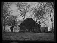 Flatlands: [Nicholas Schenck House on Canarsie Park, 1922?]. Oldest part built 1659. Benches piled outside Surrounding houses also visible.