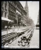 Broadway looking north from Pine Street, New York City; copy negative of a circa 1885 photograph by an unknown photographer. [Trolley tracks being laid?]