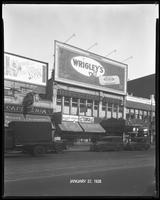 125th Street between Seventh Avenue and Lenox Avenue, New York City, January 27, 1928: Wrigley's Double Mint Gum, 'Love' (motion picture). Also storefronts of Ideal Shoe Shop, Toby's Men's Shop, Christensen School of Rag and Jazz, Orient Photo Plays, Leig