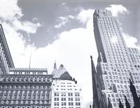 Spires of New York: Trinity Church spire in foreground and other Wall Street area building tops, including the Bankers Trust building, possibly June 1943.