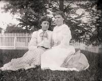 Angie and Nellie Moore in front of an evergreen tree, [Hempstead, N.Y.?], August 19, 1891.