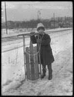 William Gray Hassler (little boy) with his new sled, ca. 1912.