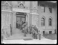 Boys in uniform with schoolbooks on the steps of the New York Parental School, Kissena Boulevard in Flushing, Queens, undated (ca. 1913-1914).