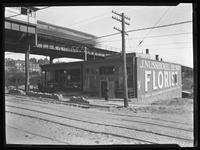 56-58 E. 161st Street, Bronx, undated (ca. 1920). Elevated train station beside. Photographed for Joseph P. Day.
