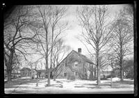 Side view of an unidentified saltbox farmhouse, undated.