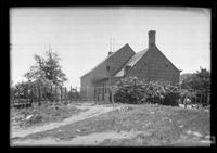 Side view of unidentified wood-shake house, undated.
