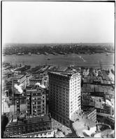 Manhattan: high-angle shot of Lower Manhattan, Brooklyn Heights, and docks on both sides of the East River, undated (ca. 1910). The Beaver Building visible at center.