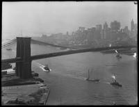 High-angle shot of the Brooklyn tower of the Brooklyn Bridge, the East River, and lower Manhattan, August 25, 1914. Shot from the Brooklyn tower of the Manhattan Bridge. Part 1 of a panorama.