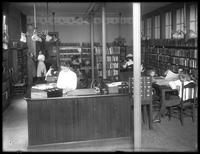 Interior view of an unidentified branch of the Queens Borough Public Library, ca. 1910.