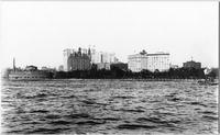 Manhattan: skyline at the tip of Lower Manhattan, viewed from the harbor, 1900. Battery and Castle Garden / New York City Aquarium in foreground.