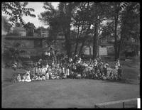Large group of children assembled for a group portrait in an unidentified playground, ca. 1910.