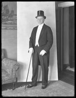Full-length portrait shot of James R. Murphy in white tie and tails, Bronx, April 25, 1915.