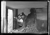 Interior view of ruined brick wall oven and hearth in unidentified dilapidated house, undated.