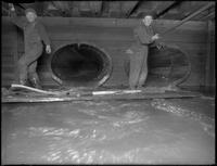 Men working in the W. 129th Street sewer, ca. 1911.