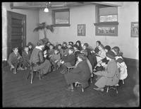 Children seated for story hour, Astoria branch of the Queens Borough Public Library, November 28, 1914.