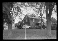 Long Island: unidentified saltbox house with addition and signpost in front, undated.