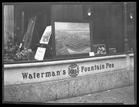 Aerial photo and advertisement for the September 23, 1919 auction of properties in the Claflin Estate in University Heights, Bronx in the window of a Waterman's Pen shop, undated [1919].