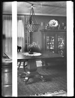Dining room in the home of Miss J.F. Hume, head librarian of the Queens Borough Public Library, Jamaica, Queens, November 15, 1914.