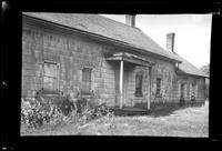 Front entry of unidentified wood-shake house, undated.