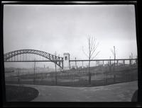 Long Island City: [Astoria Park with bare, newly planted trees, at the base of Hell Gate Bridge (New York Connecting Railroad Bridge), undated.]