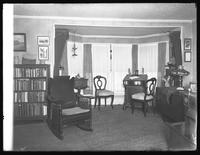 Bay window corner in the home of Miss J.F. Hume, head librarian of the Queens Borough Public Library, Jamaica, Queens, November 15, 1914.