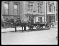 Fred Roys with horse-drawn wagon, 529 W. 20th Street, New York City, undated.