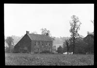 Manhasset / Roslyn / Little Neck / Douglaston / Alley Road, Long Island: [3/4 view of unidentified large saltbox house, set near the top of a hill, undated.]