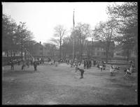 Wide shot of unidentified playground full of children, May 1, 1915. Photographed for Mrs. A.J. Blanchard.