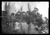 Manhasset / Roslyn / Little Neck / Douglaston / Alley Road, Long Island: [double exposure of unidentified houses, pond, and woods, undated.]