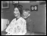 William Gray Hassler (boy) and unidentified young woman in face paint and costumes, undated (ca. 1913-1914).
