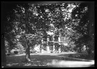 Manhasset / Roslyn / Little Neck / Douglaston / Alley Road, Long Island: [unidentified Greek-revival mansion with white-columned entryway, partly hidden behind trees, undated.]