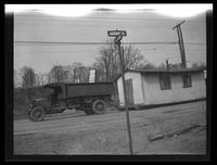 Newtown: [truck hauling a small house / large shed, at the intersection of Jackson Avenue and 24th Street, undated.]